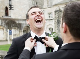 Groom and best man share a laugh